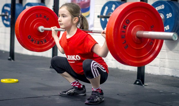 Young Girl Weight Lifting Squat